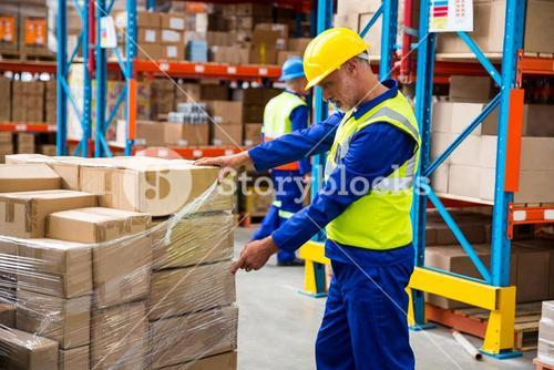 Worker opening a plastic for the boxes
