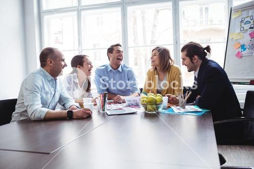 Colleagues discussing in meeting room