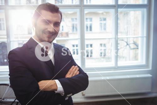 Smiling businessman in creative office