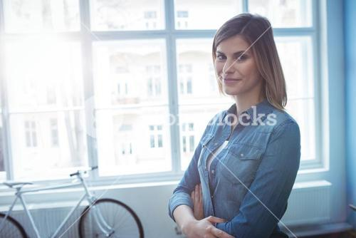 Confident businesswoman with arms cross