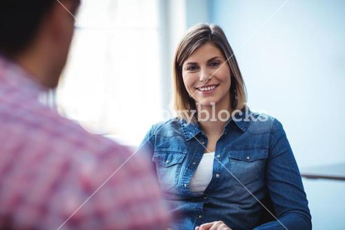 Happy businesswoman with coworker