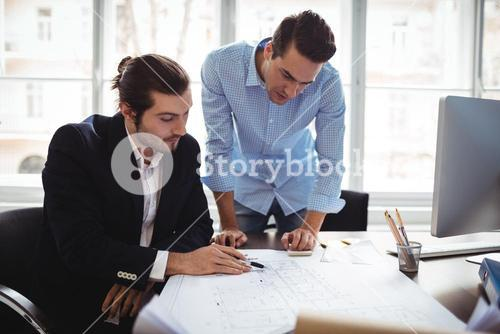 Interior designer with male colleague working in office