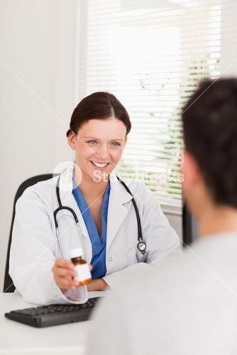 Female doctor showing pills