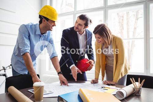 Businessman with coworkers at office