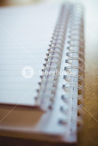 Spiral book on wooden table