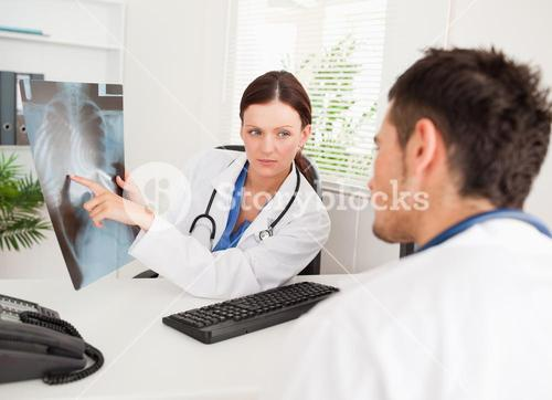 Female doctor showing other doctor xray