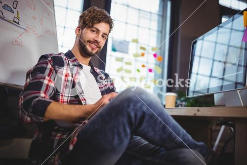 Portrait of creative businessman using digital tablet