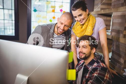 Business people looking at computer