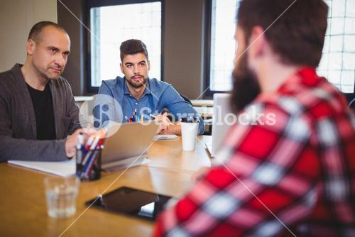 Business people discussing at desk