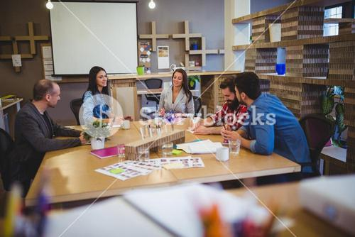 Business people discussing at table during meeting