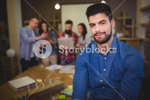 Confident young businessman in creative office