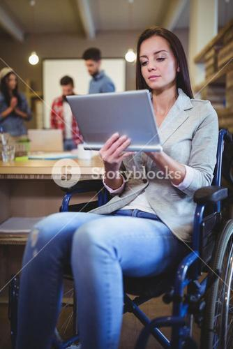 Disabled businesswoman using digital tablet