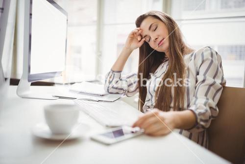 Businesswoman relaxing in creative office