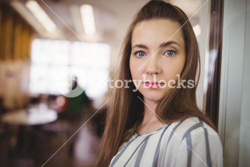 Portrait of businesswoman in office cafeteria