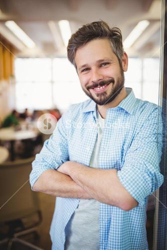 Portrait of cheerful businessman in office cafeteria