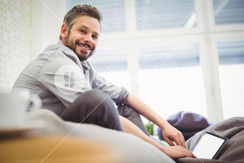 Young businessman working digital tablet in creative office