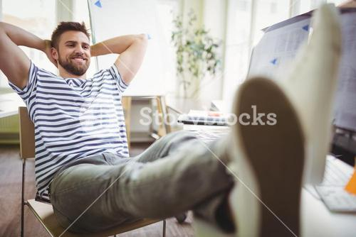 Businessman relaxing in creative office