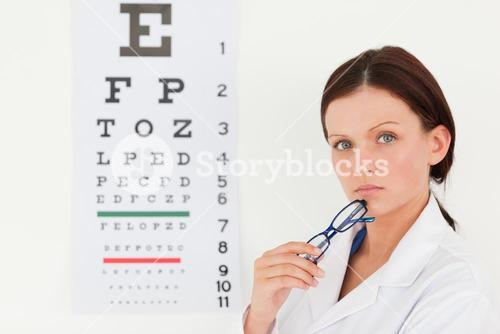 Pretty female optician and eye test
