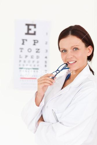 Gorgeous female optician with an eye test