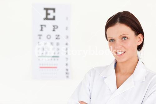 Nice female optician with eye test