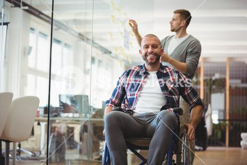Portrait of handicap businessman in creative office