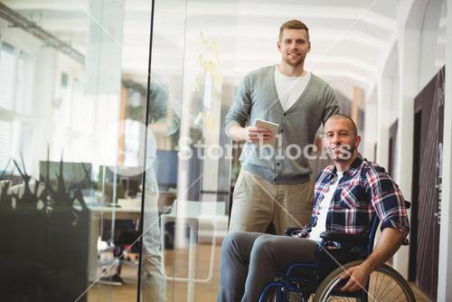 Portrait of handicap businessman with colleague in office