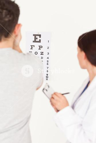 Female optician and patient in office