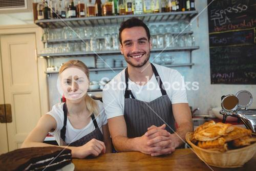 Portrait of happy employees at cafe