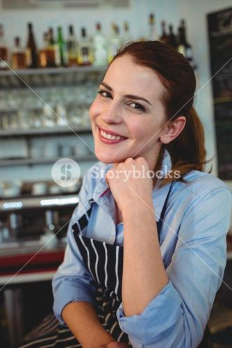 Portrait of confident barista at coffee house