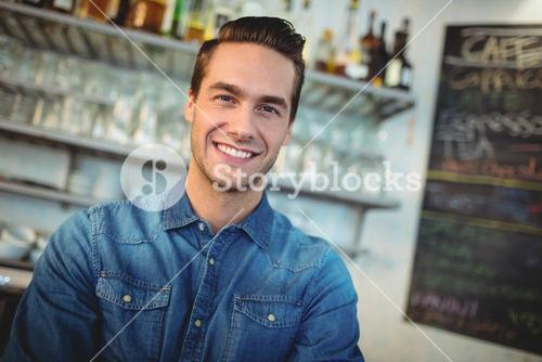 Portrait of happy cafe owner