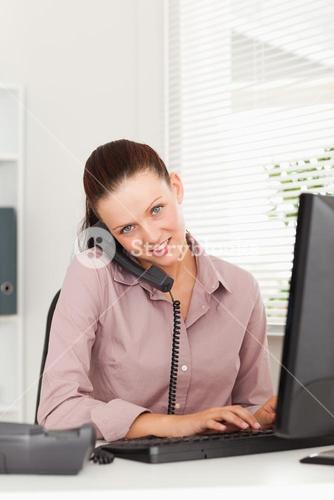 Businesswoman with phone typing