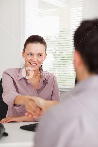 Businesswoman shaking hands with a man