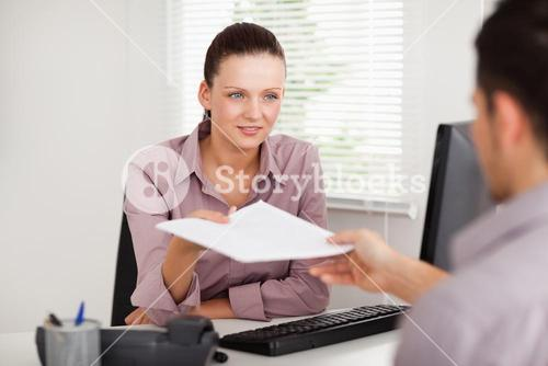 A businesswoman presenting a contract