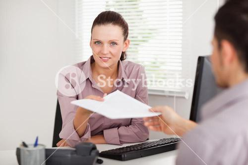 Businesswoman giving a customer a contract