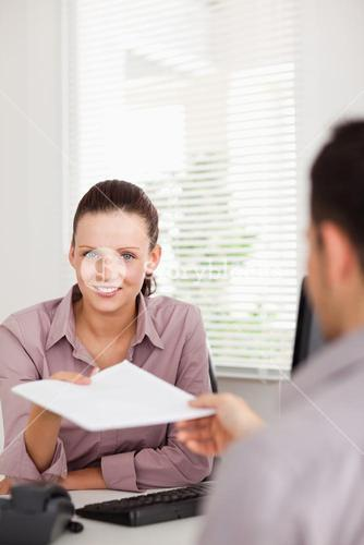 Businesswoman presenting someone a contract