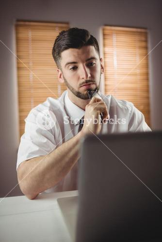 Thoughtful man working in office