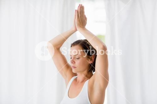 Woman with eyes closed doing yoga