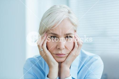 Portrait of sad senior woman