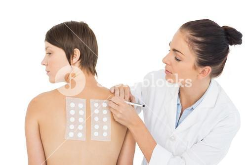 Doctor examining patient back