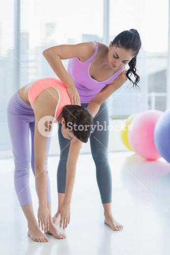 Full length of trainer working with woman