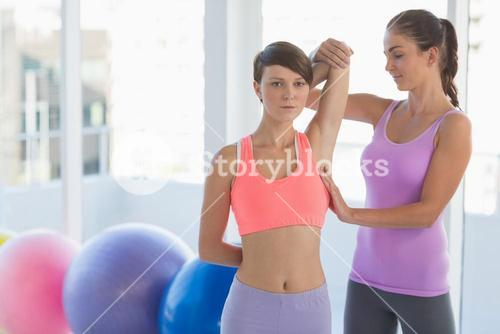 Trainer working with young woman
