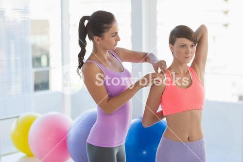 Trainer guiding woman