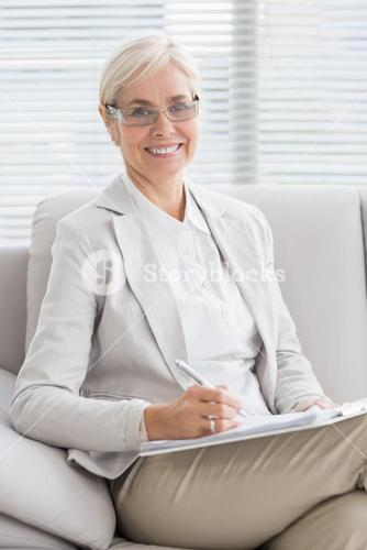 Portrait of smiling therapist in office