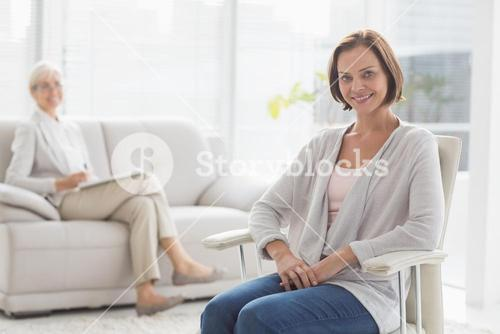 Portrait of smiling woman with therapist