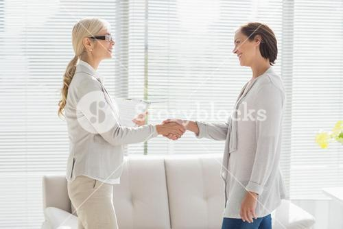 Woman and therapist shaking hands
