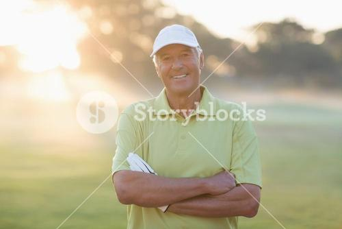 Portrait of smiling golfer with arms crossed