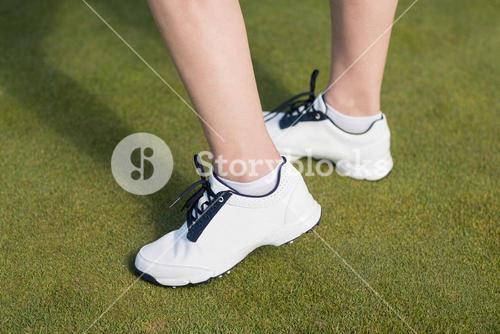 Low section of woman wearing sports shoes