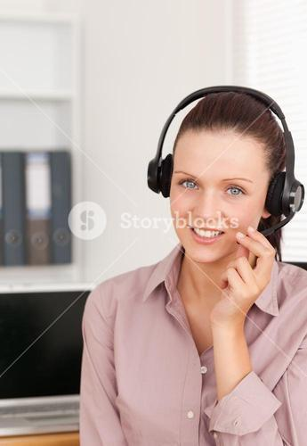 Redhaired woman with headset