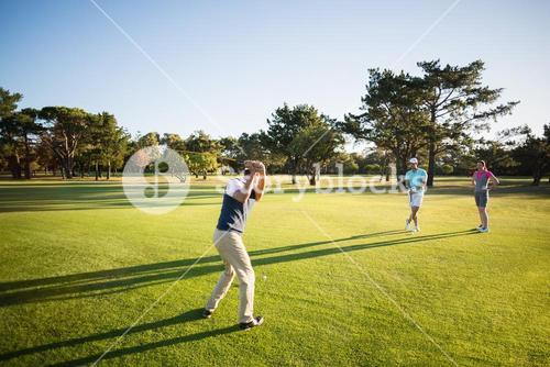 Full length of people playing golf