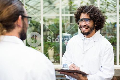 Male scientists smiling while discussing